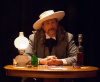 Walt Willey as Wild Bill sitting at the table